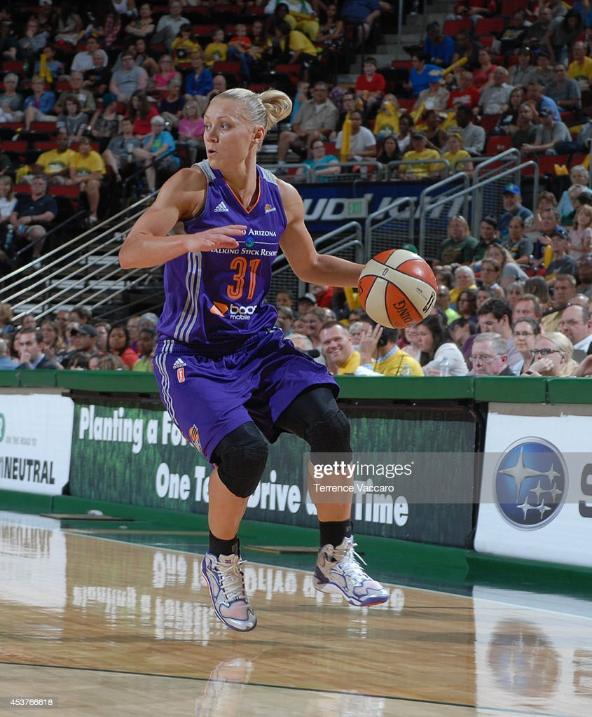 Erin Phillips #31 of the Phoenix Suns handles the ball against the Seattle Storm during the game on August 17, 2014 at Key Arena in Seattle, Washington.