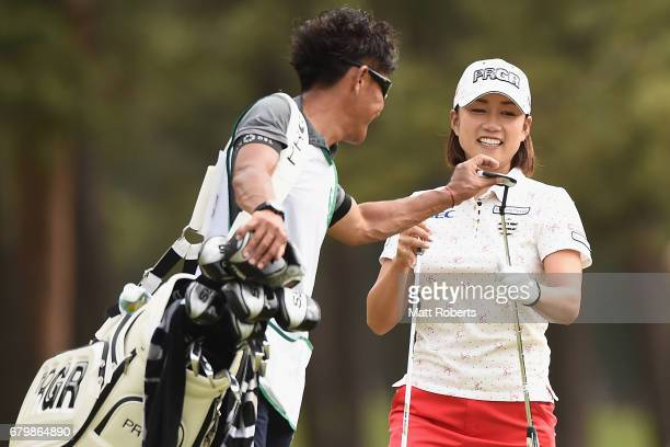 Erina Hara of Japan shares a laugh with her caddie during the final round of the World Ladies Championship Salonpas Cup at the Ibaraki Golf Club on...