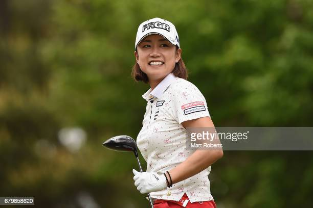 Erina Hara of Japan smiles after hitting her tee shot on the 2nd hole during the final round of the World Ladies Championship Salonpas Cup at the...