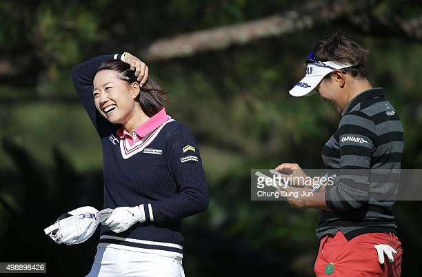 Erina Hara of Japan talks with Misuzu Narita on the 15th hole during the second round of the LPGA Tour Championship Ricoh Cup 2015 at the Miyazaki...