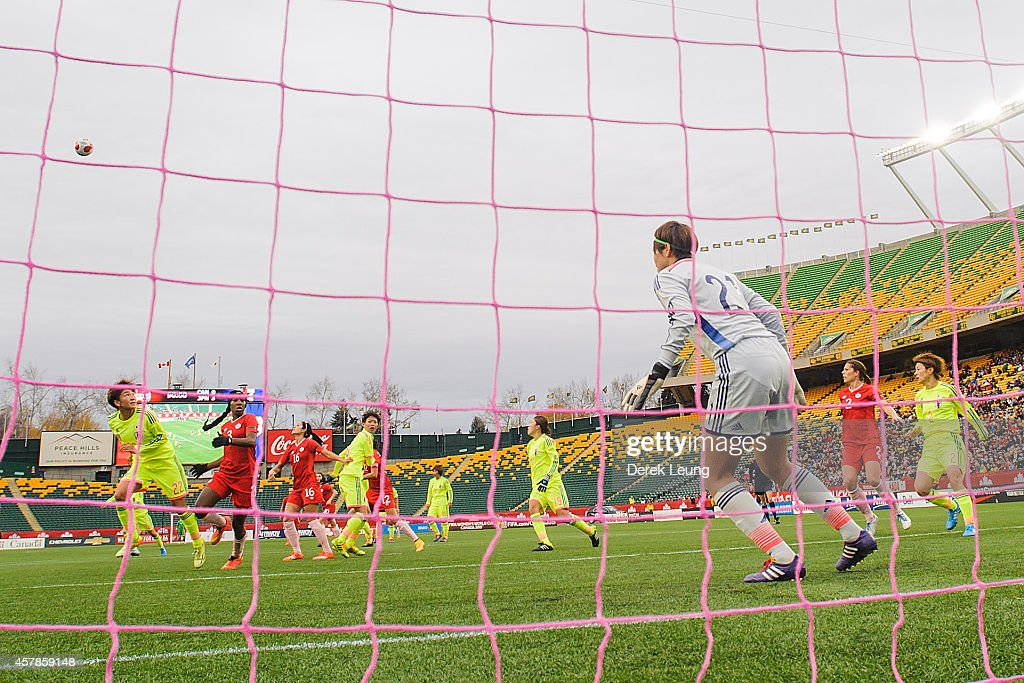 Erina Yamane #21 of Japan defends net against Canada during a match at Commonwealth Stadium on October 25, 2014 in Edmonton, Alberta, Canada.