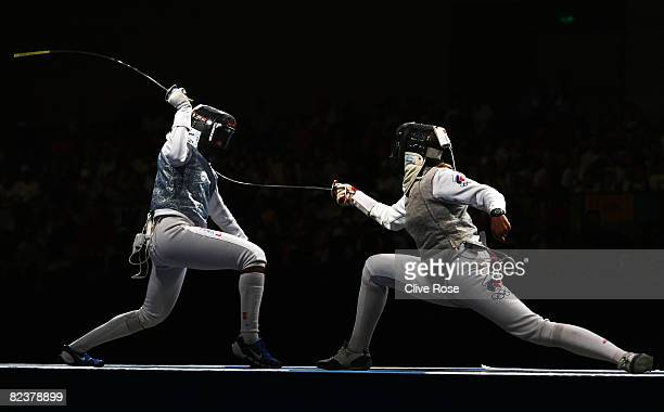 Erinn Smart of the United States competes against Victoria Nikichina of Russia in the Women's Team Foil Gold Medal Match at the Fencing Hall on Day 8...