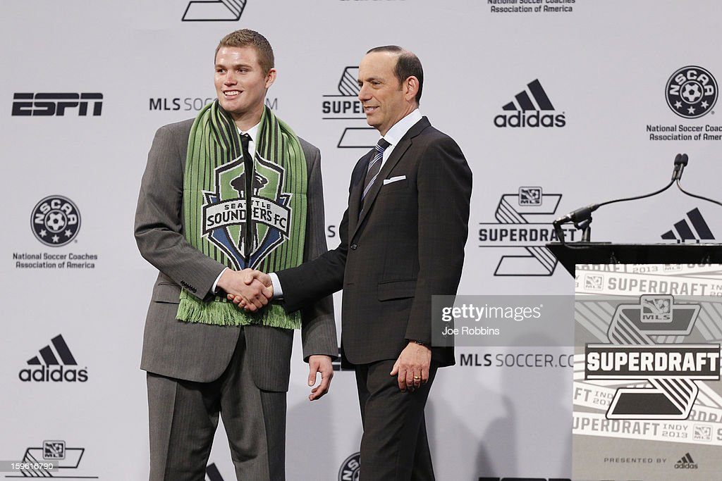 Eriq Zavaleta (L) of Indiana shakes hands with commissioner Don Garber after being selected by the Seattle Sounders as the 10th overall pick in the 2013 MLS SuperDraft Presented by Adidas at the Indiana Convention Center on January 17, 2013 in Indianapolis, Indiana.