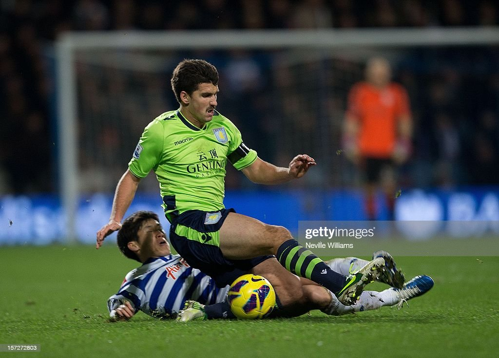 Eris Lichaj of Aston Villa challenges Ji-Sung Park of Queens Park Rangers during the Barclays Premier League match between Queens Park Rangers and Aston Villa at Loftus Road on December 01, 2012 in London, England.