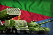 tank and missile launcher with summer pixel camouflage on the Eritrea flag background. Eritrea heavy military armored vehicles concept. 3d Illustration