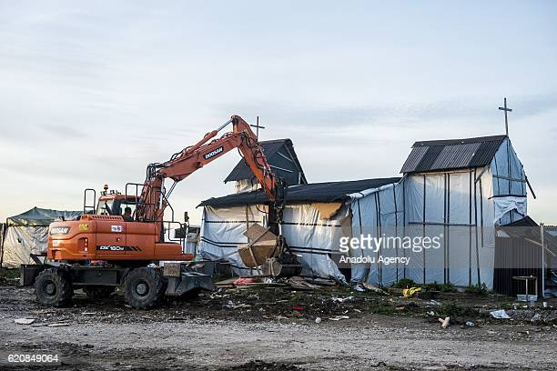 Eritrean church last place of worship of the jungle is destroyed by workers and bulldozers in Calais on November 3 2016 Over 350 women and Their...