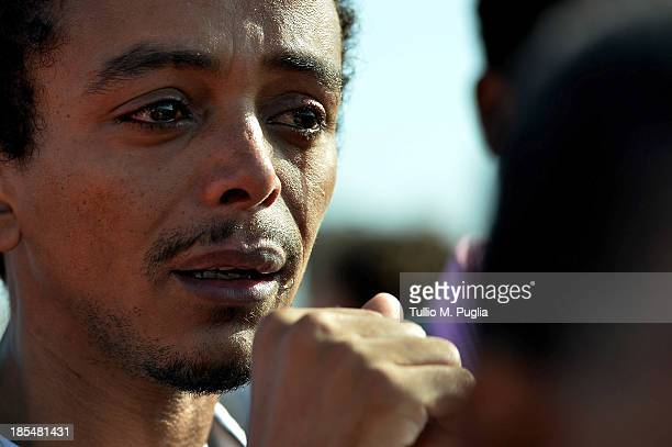 Eritrean man crying during the commemoration ceremony for the victims of the boat sinking disaster off the Lampedusa coast on October 21 2013 in San...