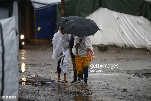 Eritrean Orthodox Christian women arrive to attend a Christmas service at a church in the camp known as 'The Jungle' on January 7 2016 in Calais...