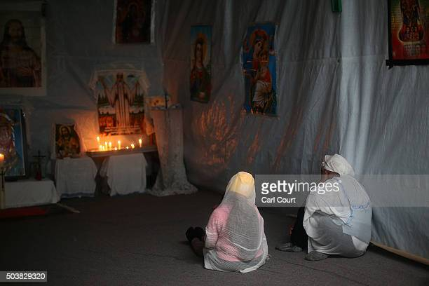 Eritrean Orthodox Christian women chat after a Christmas service at a church in the camp known as 'The Jungle' on January 7 2016 in Calais France...