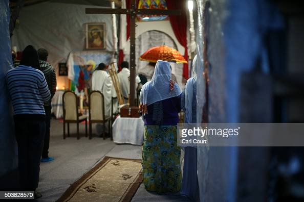 Eritrean Orthodox Christians attend a Christmas service at a church in the camp known as 'The Jungle' on January 7 2016 in Calais France Orthodox...