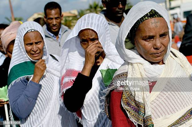 Eritrean people attend the commemoration ceremony for the victims of the boat sinking disaster off the Lampedusa coast on October 21 2013 in San...