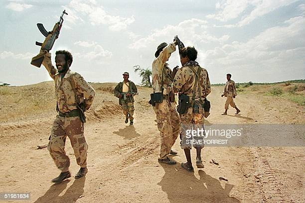 Eritrean soldiers pictured 22 September 1999 during training at the Tsorona front line south of Asmara The fresh piles of earth and the bones along...