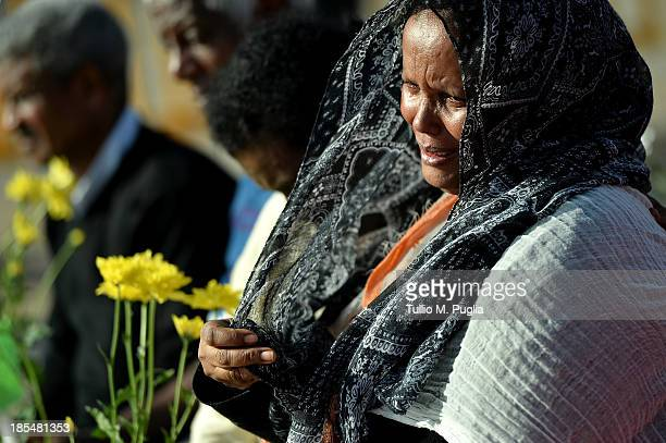Eritrean woman attends the commemoration ceremony for the victims of the boat sinking disaster off the Lampedusa coast on October 21 2013 in San...