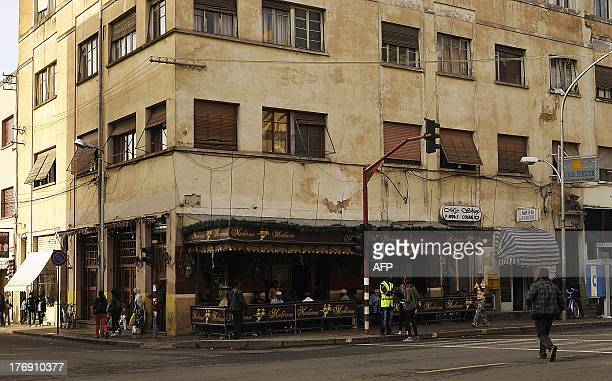 Eritreans sit in Asmara's Moderno Cafe on July 18 2013 A policy of fierce selfreliance has stifled economic growth with a gross national income of...