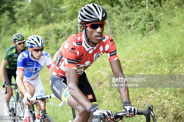 Eritrea's Daniel Teklehaimanot wearing the best climber's polka dot jersey France's Arnaud Courteille and France's Perrig Quemeneur ride in a...
