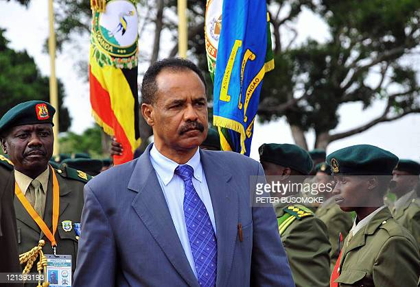 Eritrea's President Issaias Aferworki inspects an honour guard prior to his departure August 19 2011 at Entebbe State House at the end of a fourday...