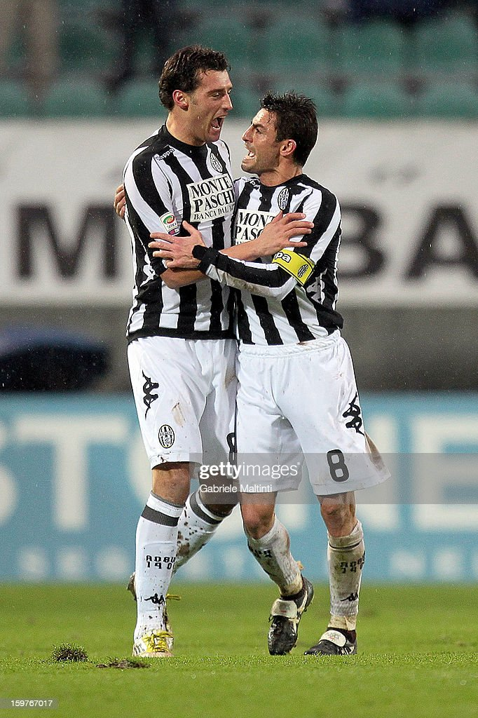 Erjon Bogdani (L) of AC Siena celebrates with team-mate Simone Vergassola after scoring the opening goal during the Serie A match between AC Siena and UC Sampdoria at Stadio Artemio Franchi on January 20, 2013 in Siena, Italy.