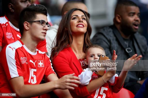 Erjona Sulejmani girlfriend of Switzerland's Blerim Dzemaili and their son Luan in the stands before the game