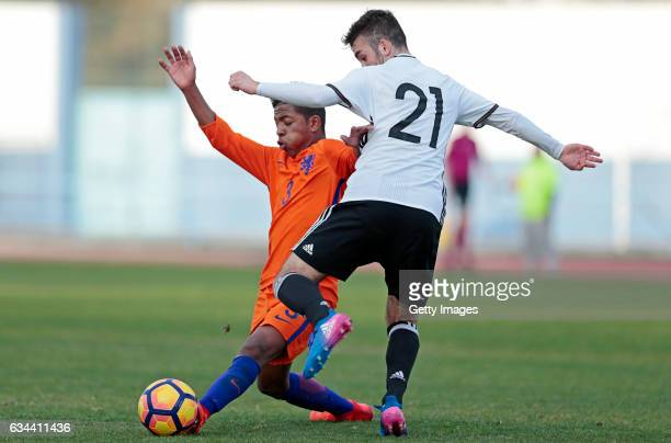Erkan Eyibil of Germany U16 challenges Shurandy Sambo of Netherlands U16 during the UEFA Development Tournament Match between Germany U16 and...