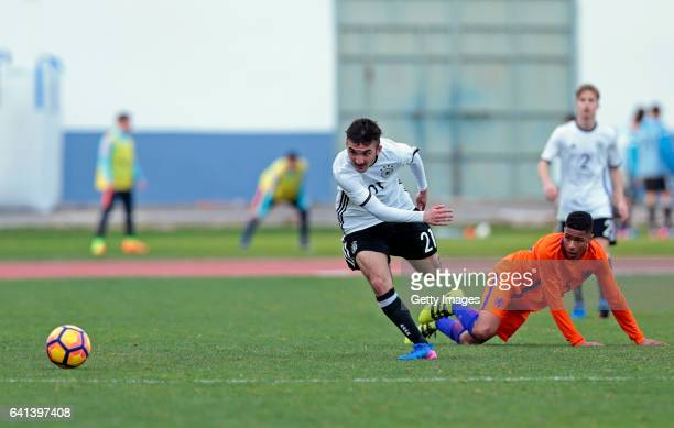 Erkan Eyibil of Germany U16 challenges Terrence Douglas of Netherlands U16 during the UEFA Development Tournament Match between Germany U16 and...