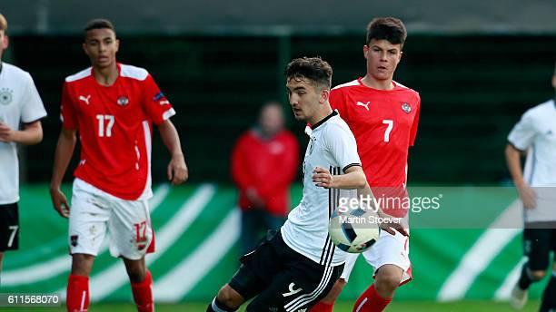 Erkan Eyibil of U16 Germany challenges Flavius Daniliuc of U16 Austria during the match between U16 Germany v U16 Austria on September 30 2016 in...