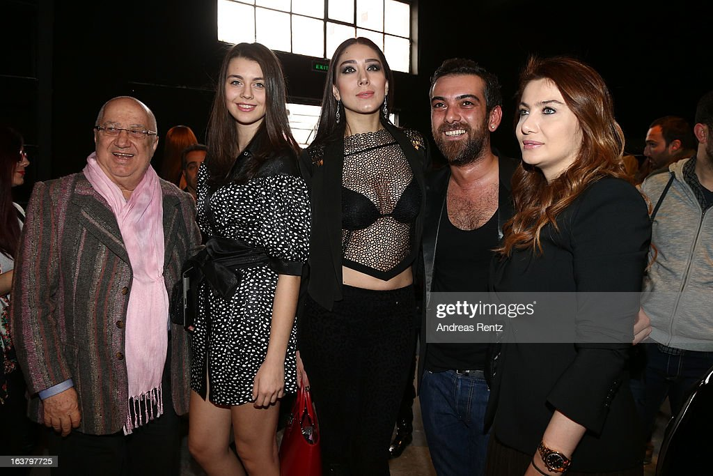 Erkan Ozakman (L), Ece Gursel (C) and Hakan Akkaya (second right) attend the Mercedes Benz Fashion Week Istanbul Fall/Winter 2013/14 at Antrepo 3 on March 15, 2013 in Istanbul, Turkey.