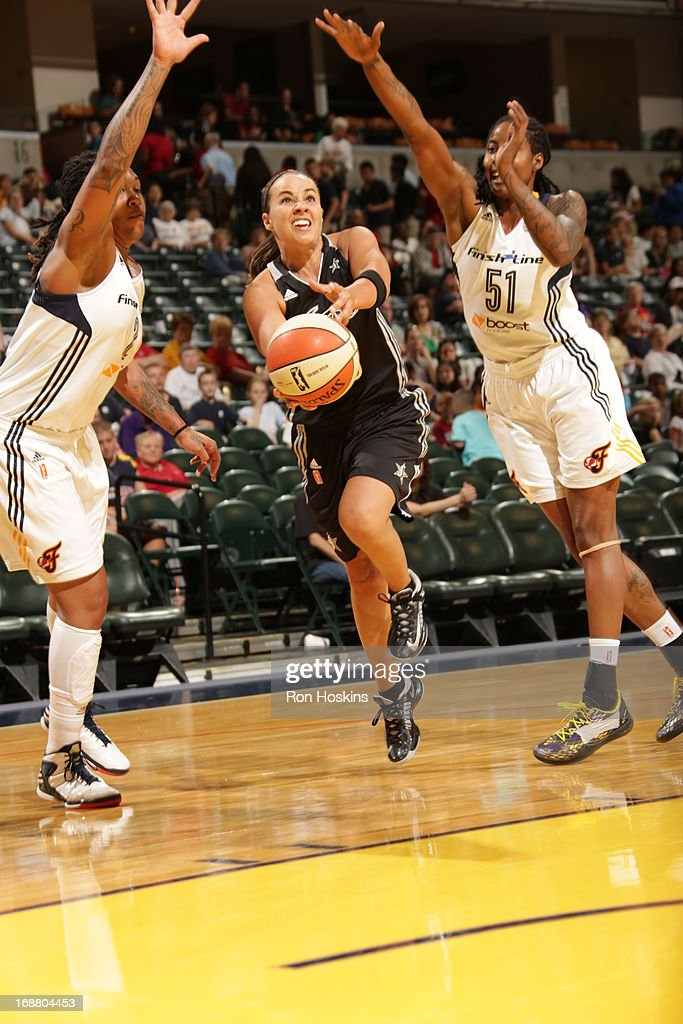 Erlana Larkins #2 and Jessica Breland #51 of the Indiana Fever try to defend against Becky Hammon #25 of the San Antonio Silver Stars on May 13, 2013 at Bankers Life Fieldhouse in Indianapolis, Indiana.