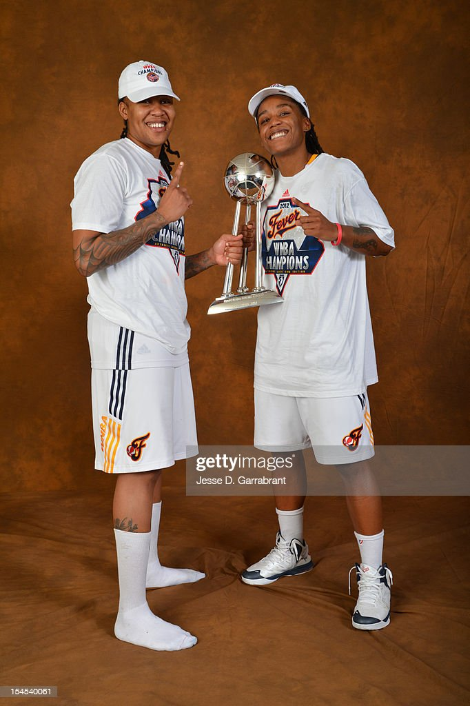 Erlana Larkins #2 and Shavonte Zellous #1 of the Indiana Fever poses for portraits with the Championship Trophy after Game four of the 2012 WNBA Finals on October 21, 2012 at Bankers Life Fieldhouse in Indianapolis, Indiana.