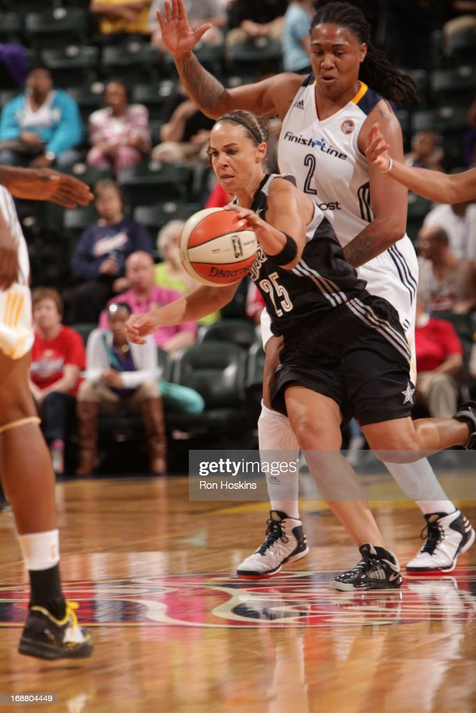 Erlana Larkins #2 of the Indiana Fever defends <a gi-track='captionPersonalityLinkClicked' href=/galleries/search?phrase=Becky+Hammon&family=editorial&specificpeople=203174 ng-click='$event.stopPropagation()'>Becky Hammon</a> #25 of the San Antonio Silver Stars on May 13, 2013 at Bankers Life Fieldhouse in Indianapolis, Indiana.