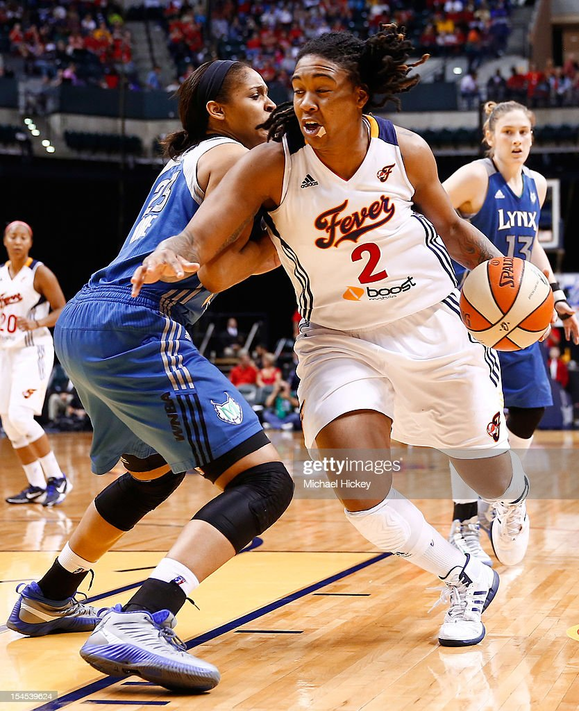 Erlana Larkins #2 of the Indiana Fever dribbles to the hoop against <a gi-track='captionPersonalityLinkClicked' href=/galleries/search?phrase=Maya+Moore&family=editorial&specificpeople=4215914 ng-click='$event.stopPropagation()'>Maya Moore</a> #23 of the Minnesota Lynx during Game Four of the 2012 WNBA Finals on October 21, 2012 at Bankers Life Fieldhouse in Indianapolis, Indiana.