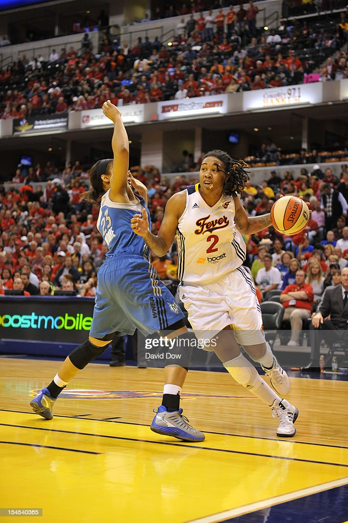 Erlana Larkins #2 of the Indiana Fever drives against Maya Moore #23 of the Minnesota Lynx during Game four of the 2012 WNBA Finals on October 21, 2012 at Bankers Life Fieldhouse in Indianapolis, Indiana.