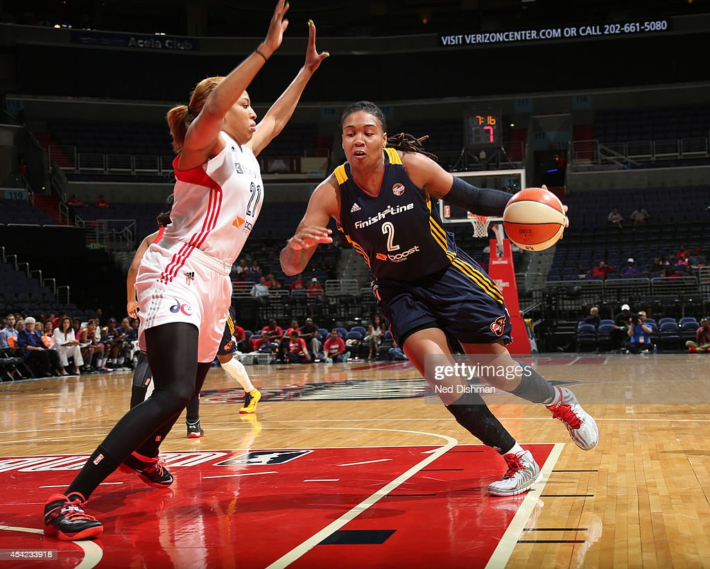 Erlana Larkins #2 of the Indiana Fever drives to the basket against Tianna Hawkins #21 of the Washington Mystics in Game Two of the Eastern Conference Semifinals during the 2014 WNBA Playoffs on August 23, 2014 at the Verizon Center in Washington, DC.