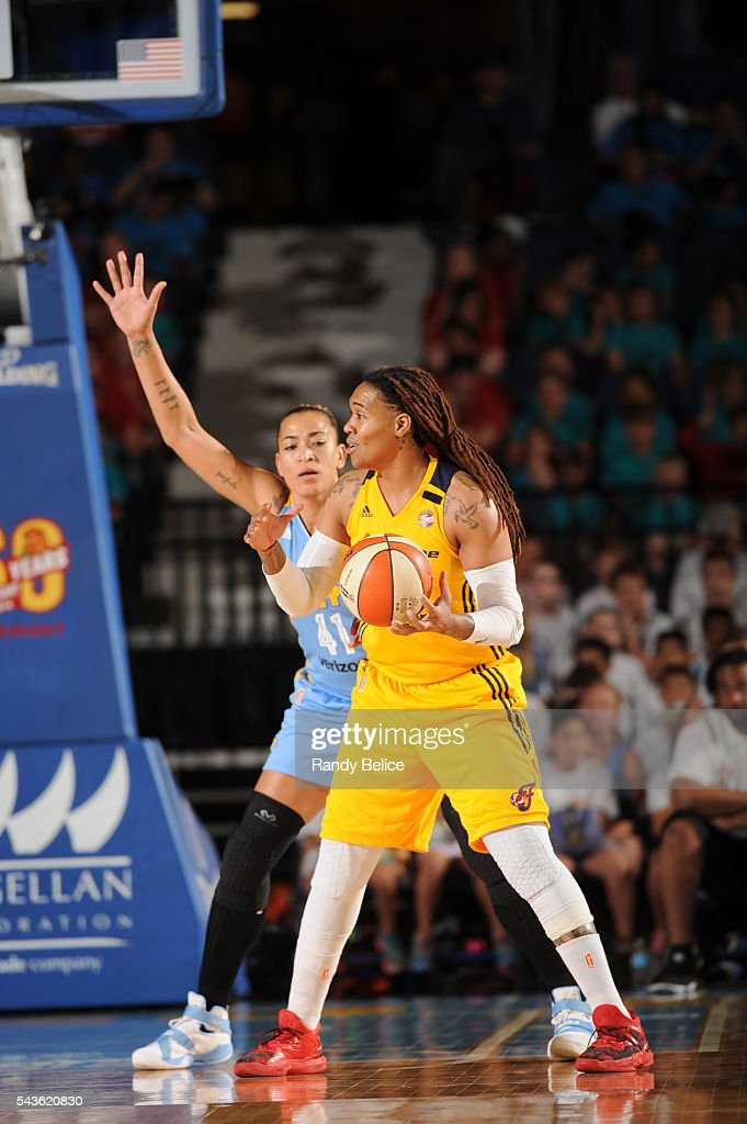 Erlana Larkins #2 of the Indiana Fever handles the ball against Erika de Souza #41 of the Chicago Sky on June 29, 2016 at Allstate Arena in Rosemont, IL.