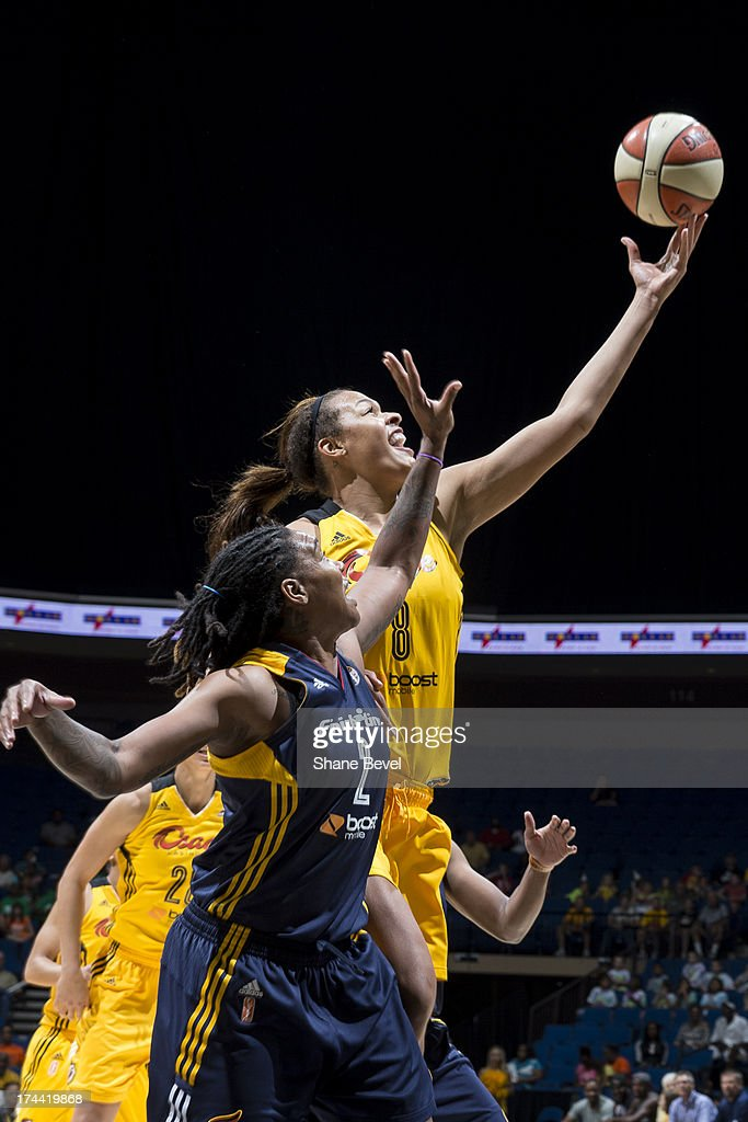 Erlana Larkins #2 of the Indiana Fever reaches for a rebound against Elizabeth Cambage #8 of the Tulsa Shock during the WNBA game on July 25, 2013 at the BOK Center in Tulsa, Oklahoma.