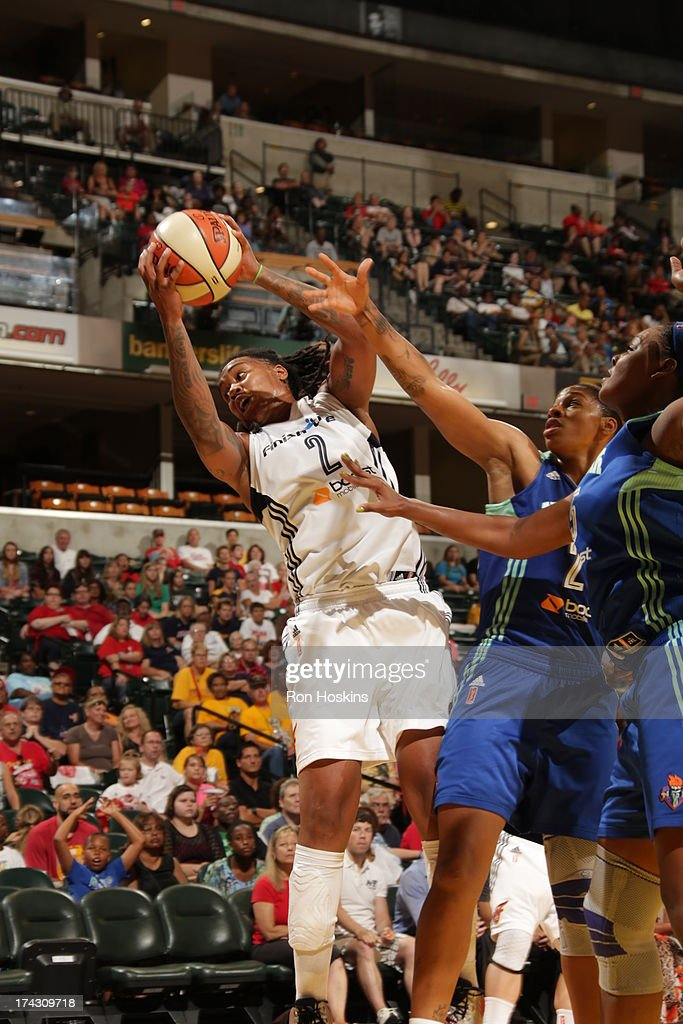 Erlana Larkins #2 of the Indiana Fever rebounds over several New York Liberty defenders on July 23, 2013 at Bankers Life Fieldhouse in Indianapolis, Indiana.
