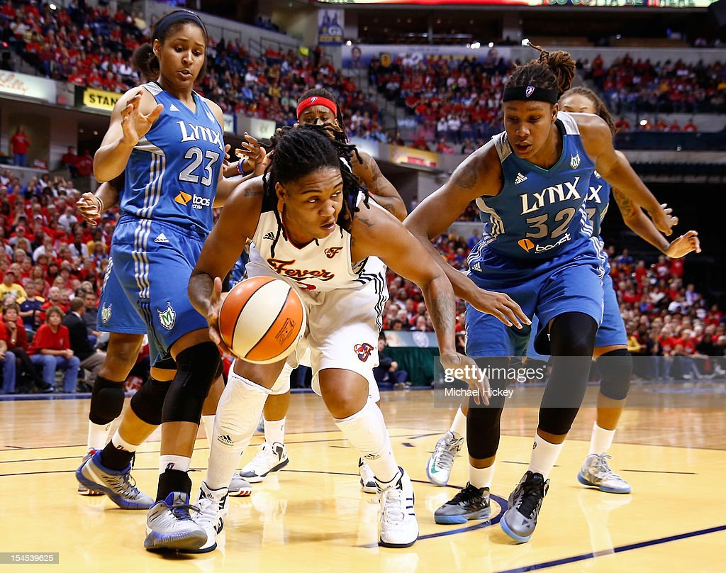 Erlana Larkins #2 of the Indiana Fever tries to keep the ball in bounds as <a gi-track='captionPersonalityLinkClicked' href=/galleries/search?phrase=Maya+Moore&family=editorial&specificpeople=4215914 ng-click='$event.stopPropagation()'>Maya Moore</a> #23 of the Minnesota Lynx and <a gi-track='captionPersonalityLinkClicked' href=/galleries/search?phrase=Rebekkah+Brunson&family=editorial&specificpeople=213521 ng-click='$event.stopPropagation()'>Rebekkah Brunson</a> #32 of the Minnesota Lynx look on during Game Four of the 2012 WNBA Finals on October 21, 2012 at Bankers Life Fieldhouse in Indianapolis, Indiana.