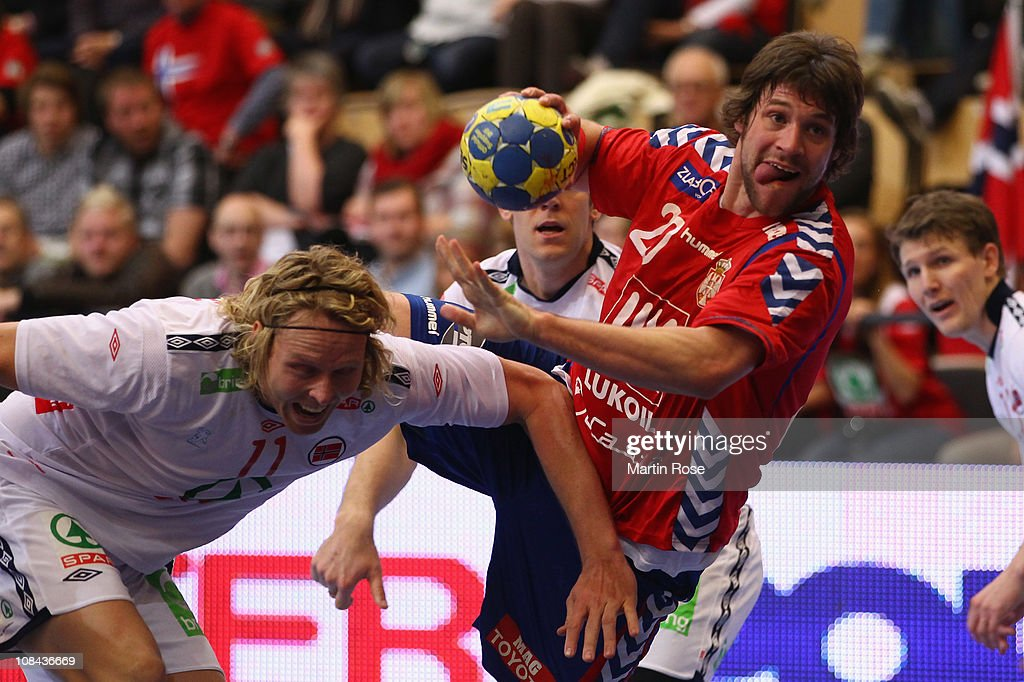 <a gi-track='captionPersonalityLinkClicked' href=/galleries/search?phrase=Erlend+Mamelund&family=editorial&specificpeople=4586128 ng-click='$event.stopPropagation()'>Erlend Mamelund</a> (L) of Norway is challenged by Momir Rnic (R) of Serbia during the Men's Handball World Championship placement match between Norway and Serbia at Kristianstad Arena on January 27, 2011 in Kristianstad, Sweden.