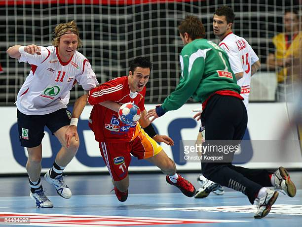 Erlend Mamelund of Norway tackles Vladimir Temelkov of Macedonia during the Men's World Handball Championships main round match group two between...