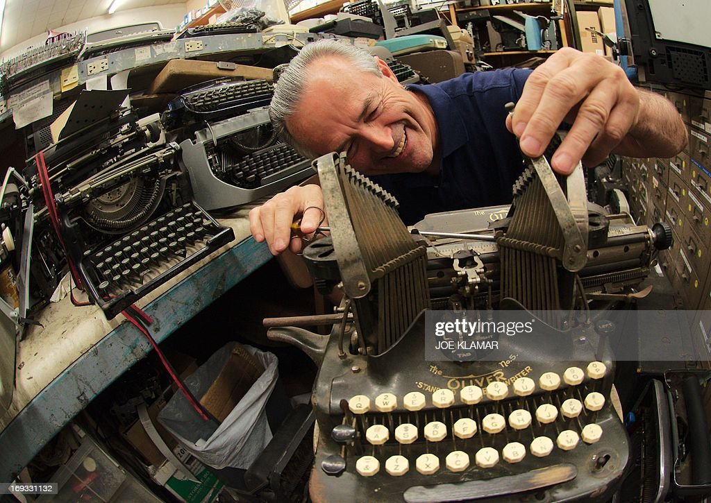 Ermanno Marzorati, owner of Star Office Machines is working on an old typewriter in his shop in Los Angeles, California on May 03, 2013.