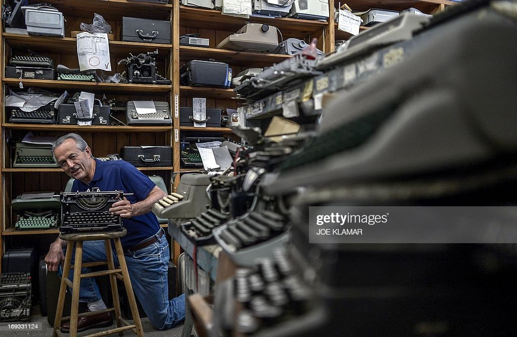 Ermanno Marzorati, owner of Star Office Machines shows off some old typewriters in his shop in Los Angeles, California on May 03, 2013. In his workshop, the 68 year old Italian, who has resided in Los Angeles since 1969, restored typewriters belonging to Ian Fleming - the creator of James Bond - Tennessee Williams, Ray Bradbury, Ernest Hemingway, Orson Welles and John Lennon.