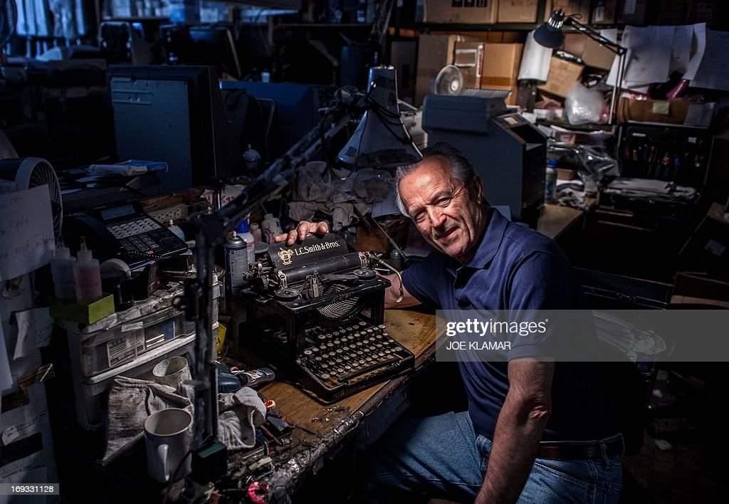 Ermanno Marzorati, owner of Star Office Machines works on an old typewriter in his shop in Los Angeles, California on May 03, 2013. In his workshop, the 68 year old Italian, who has resided in Los Angeles since 1969, restored typewriters belonging to Ian Fleming - the creator of James Bond - Tennessee Williams, Ray Bradbury, Ernest Hemingway, Orson Welles and John Lennon.