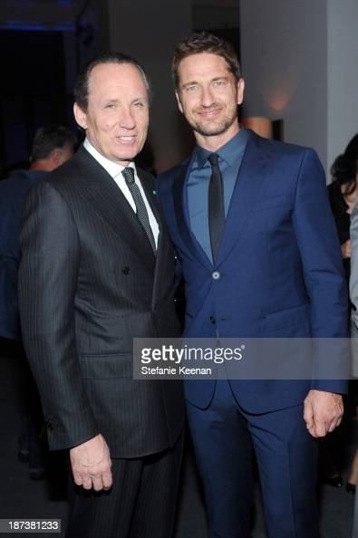 Ermenegildo Zegna CEO Gildo Zegna and actor Gerard Butler attend the Ermenegildo Zegna Eminences Grises unveiling hosted by Gildo Zegna and Stefano...