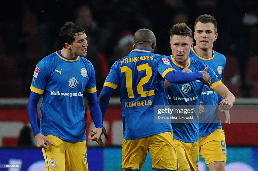 Ermin Bicakcic of Braunschweig celebrates with teammate Dominik Kumbela after scoring his team's second goal during the Bundesliga match between 1. FC Koeln and Eintracht Braunschweig at RheinEnergieStadion on December 10, 2012 in Cologne, Germany.
