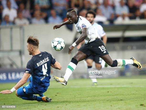 Ermin Bicakcic of Hoffenheim and Sadio Mane of Liverpool during the UEFA Champions League Qualifying PlayOffs Round First Leg match between 1899...