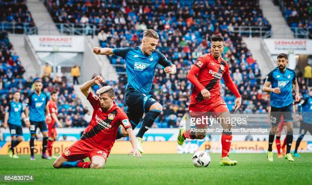 Ermin Bicakcic of Hoffenheim in action against Kevin Kampl of Leverkusen during the Bundesliga match between TSG 1899 Hoffenheim and Bayer 04...