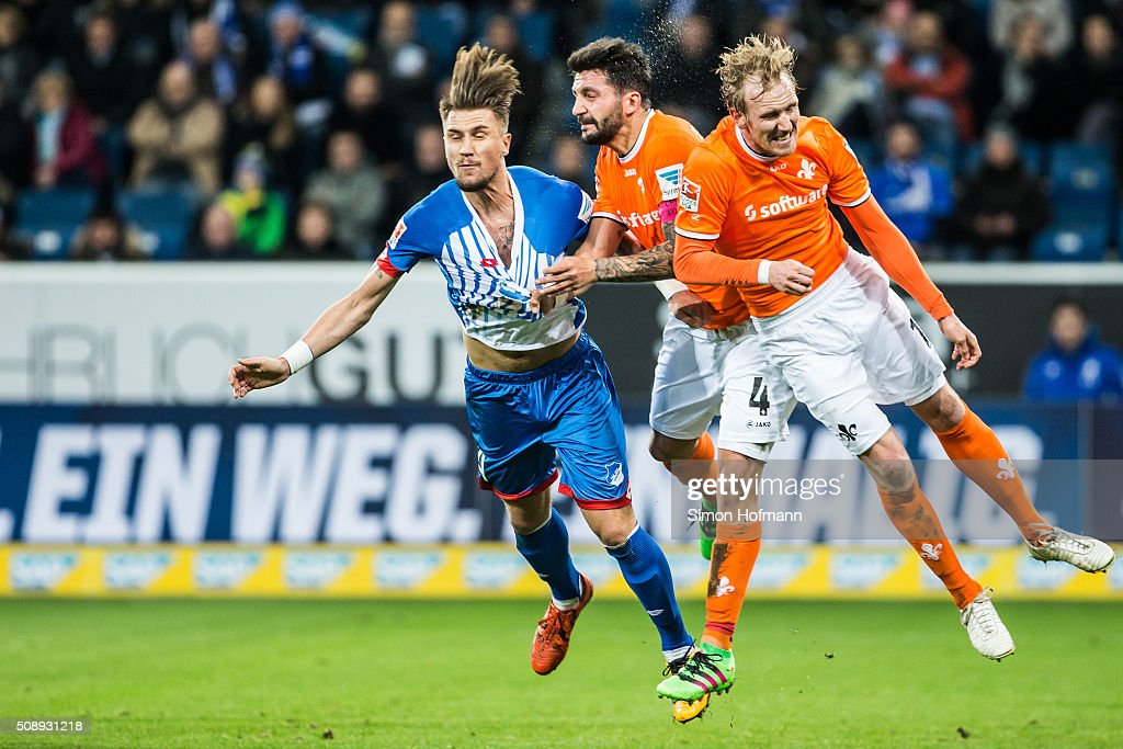 Ermin Bicakcic of Hoffenheim is challenged by Aytac Sulu of Darmstadt (C) during the Bundesliga match between 1899 Hoffenheim and SV Darmstadt 98 at Wirsol Rhein-Neckar-Arena on February 7, 2016 in Sinsheim, Germany.