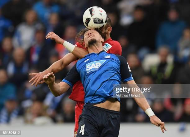 Ermin Bicakcic of Hoffenheim jumps for a header with Oemer Toprak of Leverkusen during the Bundesliga match between TSG 1899 Hoffenheim and Bayer 04...