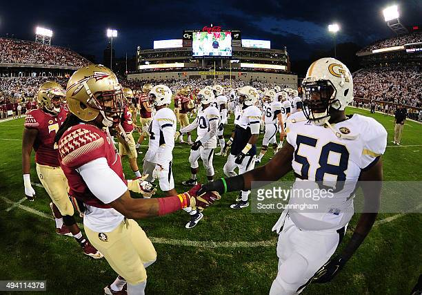 Ermon Lane of the Florida State Seminoles greets Freddie Burden of the Georgia Tech Yellow Jackets at midfield before the game in an ACC...