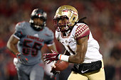 Ermon Lane of the Florida State Seminoles scores a 47 yard touchdown pass thrown by Jameis Winston in the fourth quarter against the Louisville...