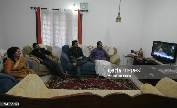 Ernakulam 8th February 2011 Sreesanth's family members including mother Savithri Devi and father Santhakumaran Nair watch the news channels as the...